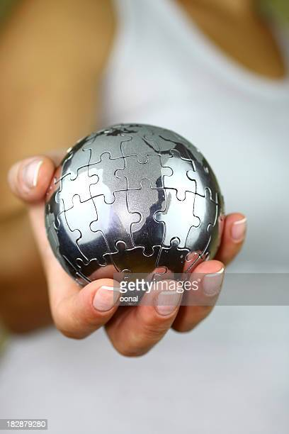 Puzzle del globo in mano