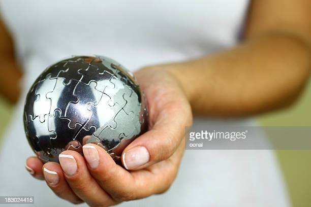 Puzzle globe in hand