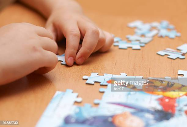 puzzle in kid hands
