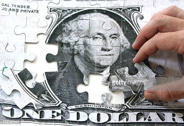 Puzzle of one dollar bill with two missing pieces