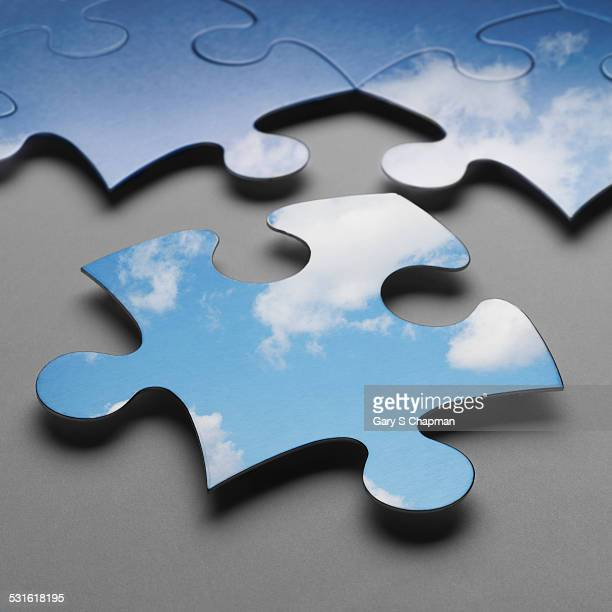 Puzzle pieces and clouds