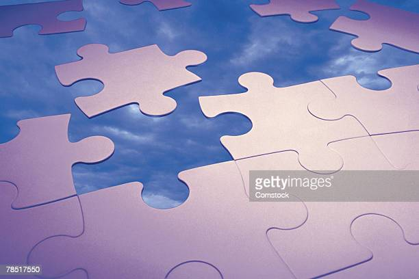 Puzzle pieces and sky