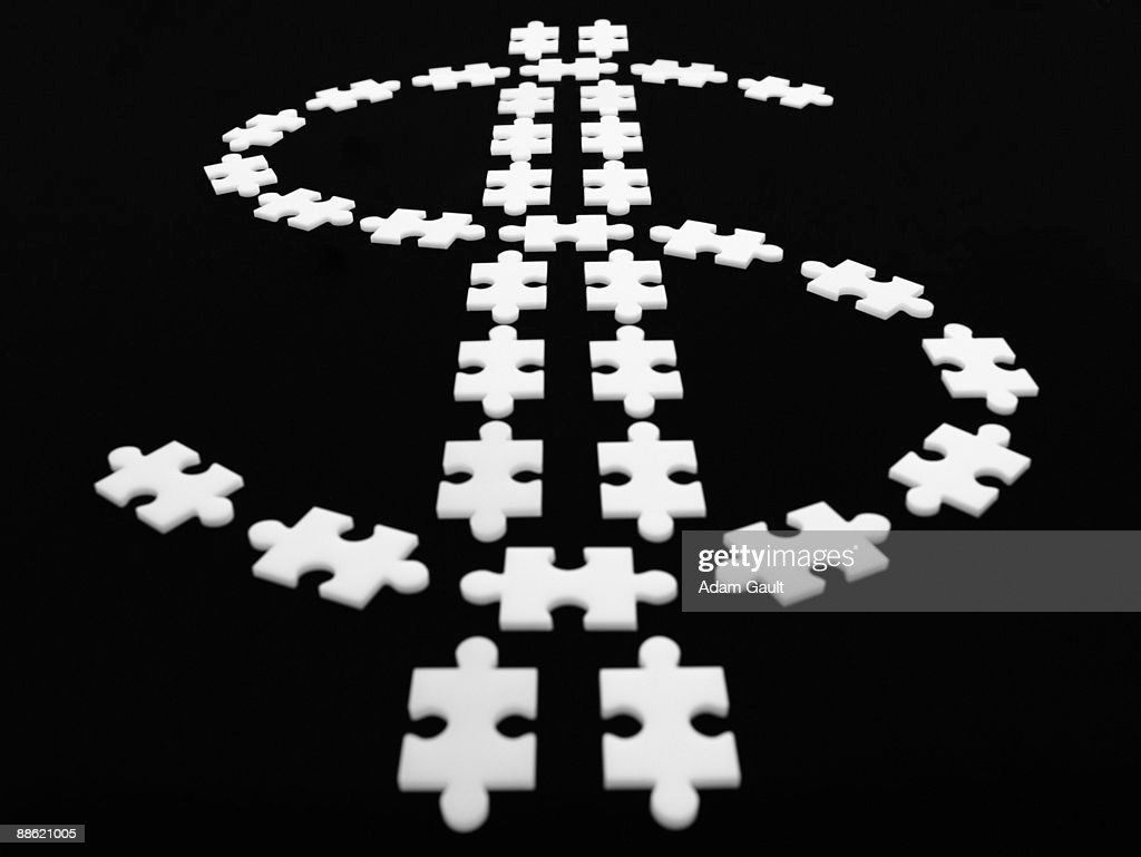 Puzzle pieces in shape of dollar sign : Stock Photo