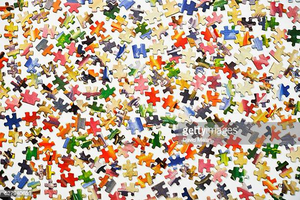 Puzzle pieces on a white surface