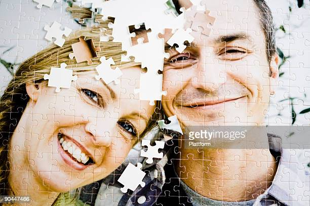 A puzzle with the image of a couple.
