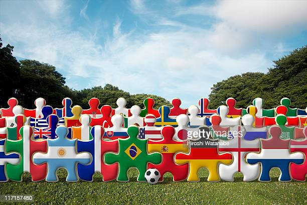 Puzzles of national flags holding hands in a row