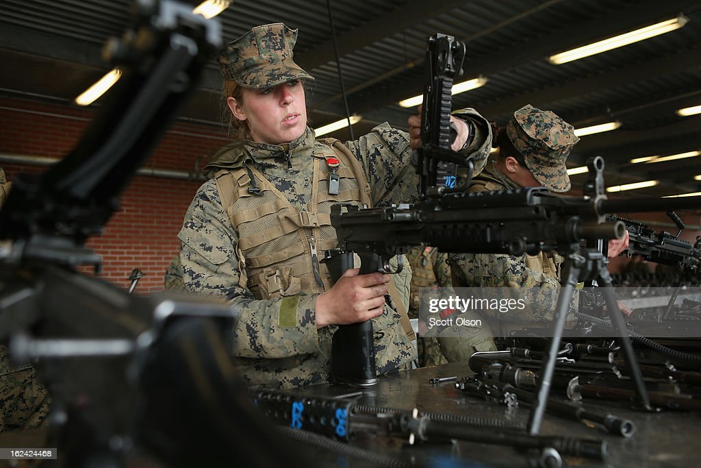 Pvt. Megan Randall of Huntersville, North Carolina cleans a machine gun during Marine Combat Training (MCT) on February 22, 2013 at Camp Lejeune, North Carolina. Since 1988 all non-infantry enlisted male Marines have been required to complete 29 days of basic combat skills training at MCT after graduating from boot camp. MCT has been required for all enlisted female Marines since 1997. About six percent of enlisted Marines are female.