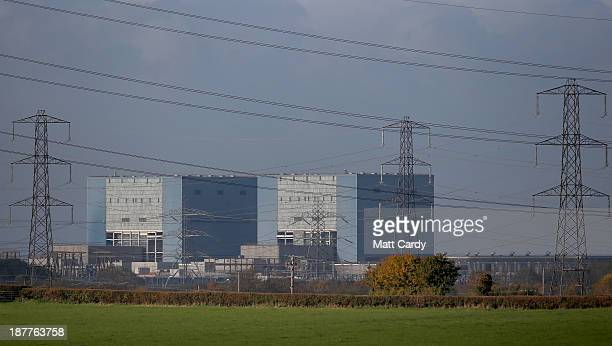 Pylons are seen in the front of Hinkley Point A nuclear power station near Bridgwater on November 12 2013 in Somerset England EDF who last month...