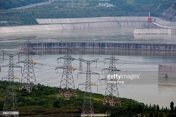 Pylons are transmitting the electricity generated from the dam The Three Gorges Dam is the world's largest power station in terms of installed...