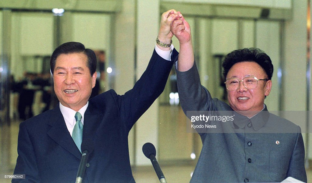 Pyongyang, North Korea - File photo taken in June 2000 shows South Korean President Kim Dae Jung (L) and North Korean leader Kim Jong Il holding hands ahead of the signing of a joint declaration at their summit in Pyongyang.