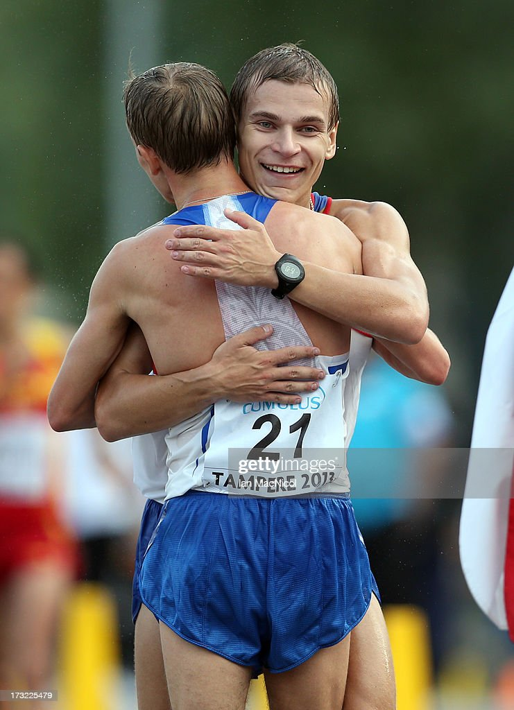 Pyotr Bogatyrev of Russia is congratulated by team mate Aleksandr Ivanov after he crosses the line to claim victory during the men's 20km Walk Race...