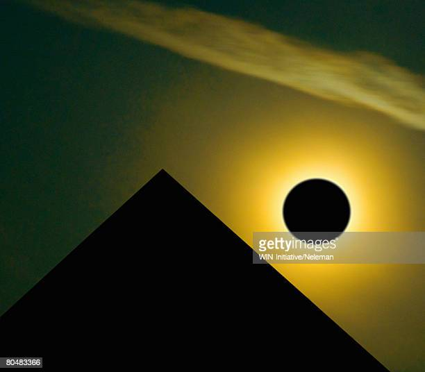 Pyramid and eclipse, close-up