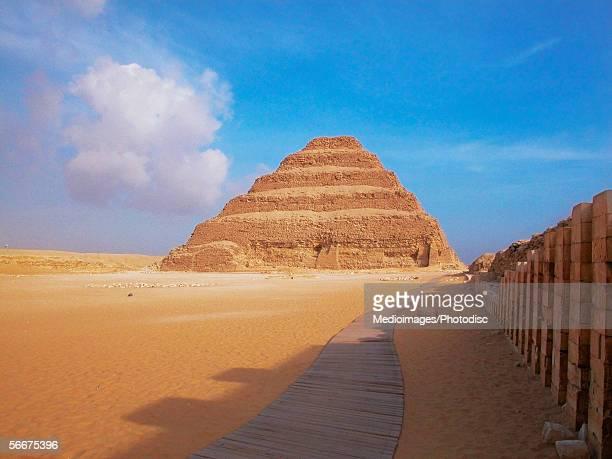 Pyramid in an arid landscape, The Step Pyramid Of Zoser, Saqqara, Egypt