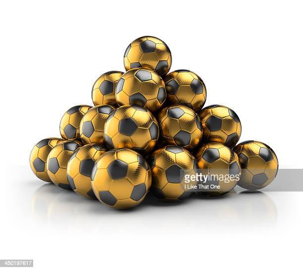 Pyramid made from gold footballs