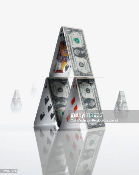Pyramid made of US Dollars and playing cards
