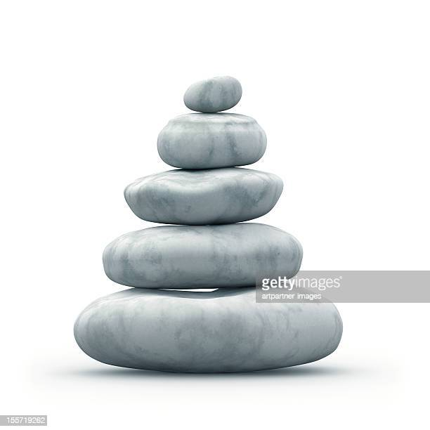 A pyramid of balanced stones on a white background