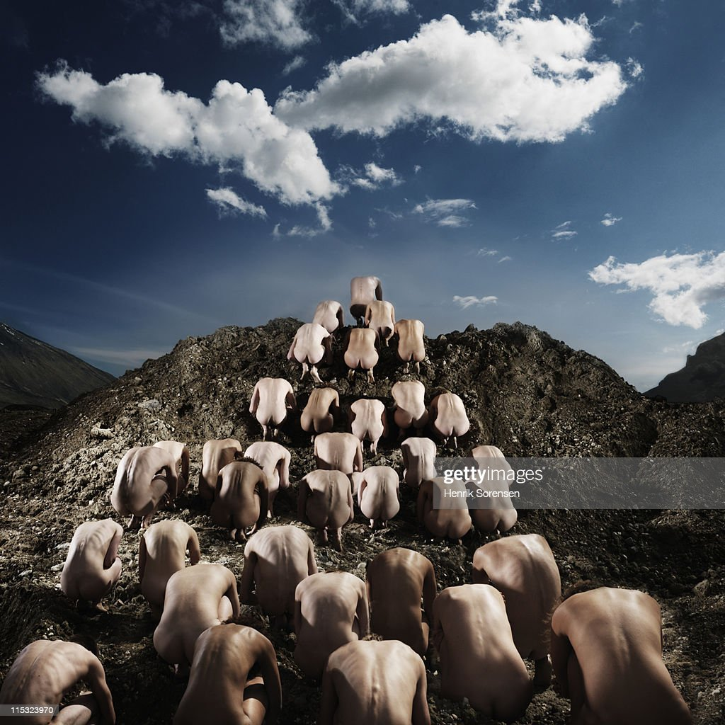 pyramid of naked people crawling upwards : Stock Photo