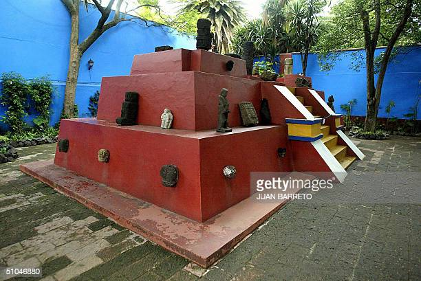 A pyramidal sculpture is seen is seen in the central patio of the Mexican artist Frida Kahlo's Blue House in southern Mexico City 09 July 2004 Five...