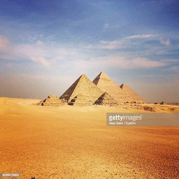 Pyramids In Desert Against Sky