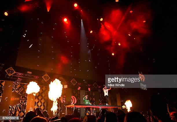 Pyrotechnics are deployed while recording artists Alex Pall and Andrew Taggart of music group The Chainsmokers perform onstage at 1061 KISS FM's...