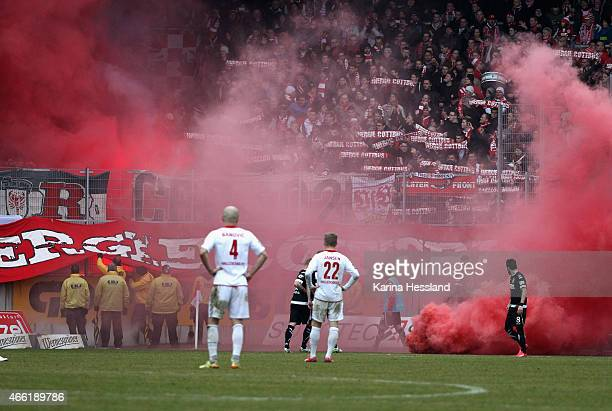 Pyrotechnics by the Fans of Cottbus during the Third League match between Hallescher FC and FC Energie Cottbus at ErdgasSportpark on March 14 2015 in...