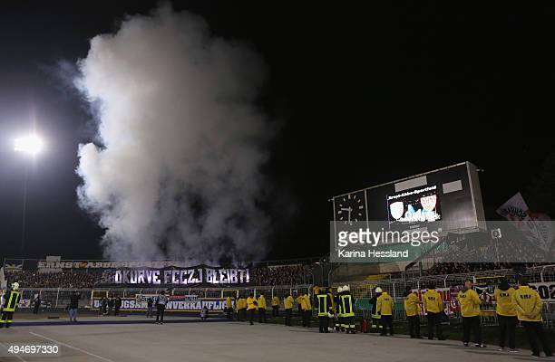Pyrotechnics by the fans of Jena during the DFB Cup between FC Carl Zeiss Jena and VFB Stuttgart at ErnstAbbeSportfeld on October 28 2015 in Jena...