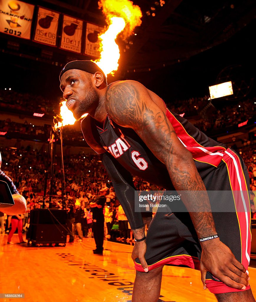 Pyrotechnics go off as LeBron James #6 of the Miami Heat awaits his introduction before a game against the Indiana Pacers on March 10, 2013 at American Airlines Arena in Miami, Florida.