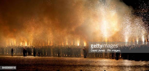 Pyrotechnics on the seashore off Weymouth Esplanade as people take part in the 'Battle of the Winds' festival which coincides with Olympic regatta at...