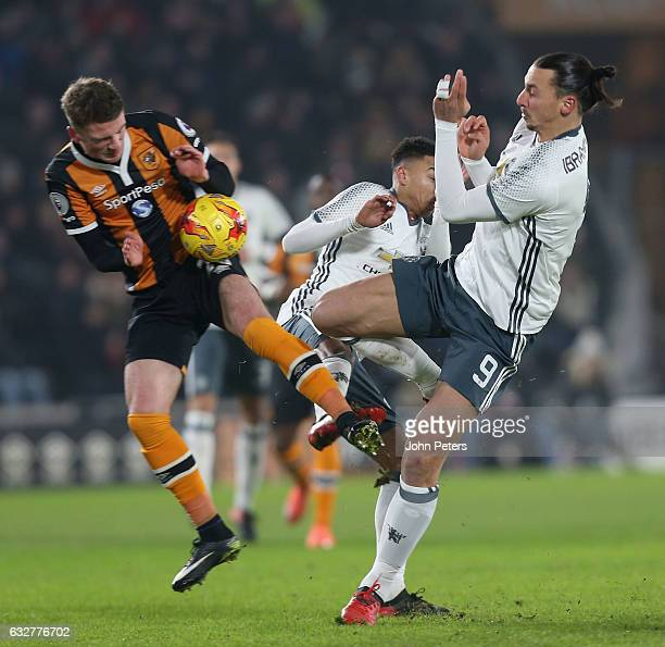 PZlatan Ibrahimovic of Manchester United in action with Josh Tymon of Hull City during the EFL Cup SemiFinal second leg match between Hull City and...
