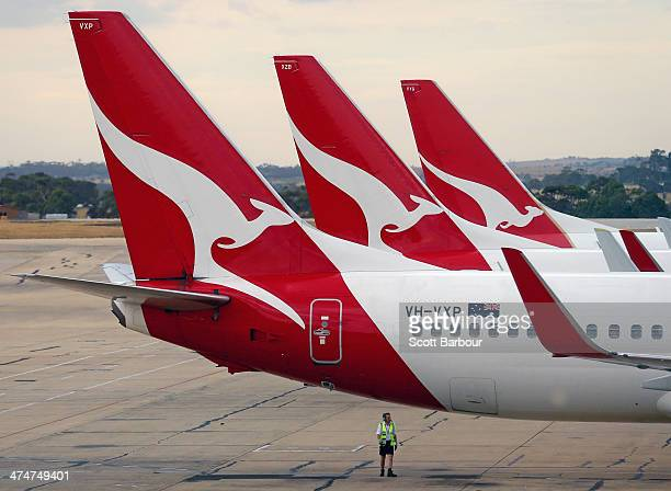 Qantas aeroplanes wait at Melbourne Tullamarine Airport on February 25 2014 in Melbourne Australia On Thursday Qantas will announce their half year...