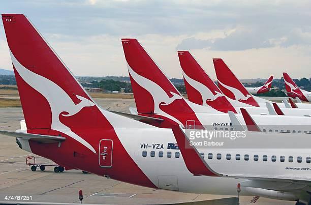 Qantas aeroplanes wait at Melbourne Tullamarine Airport on February 25 2014 in Melbourne Australia On Thursday Qantas will announce their half year...