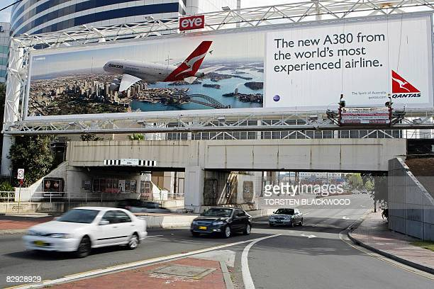 A Qantas Airbus A380 features on a billboard on the day the first Qantas Airbus A380 touches down at Sydney International Airport on September 21...