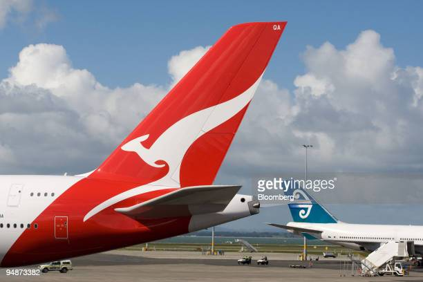 Qantas Airways Ltd Airbus A380 jet stands next to an Air New Zealand jet at the new pier at Auckland International Airport in Auckland New Zealand on...