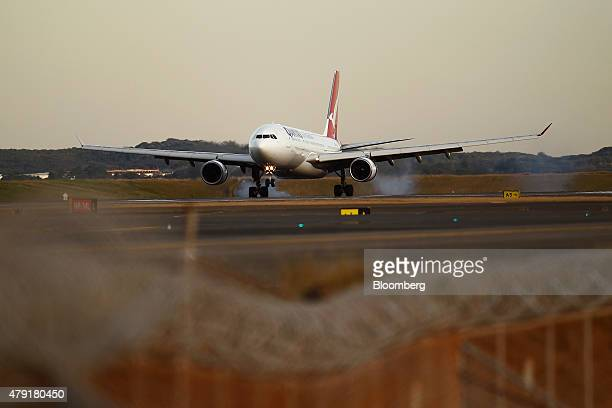 A Qantas Airways Ltd aircraft lands at Sydney Airport in Sydney Australia on Monday June 22 2015 Australia's central bank reiterated the need for...