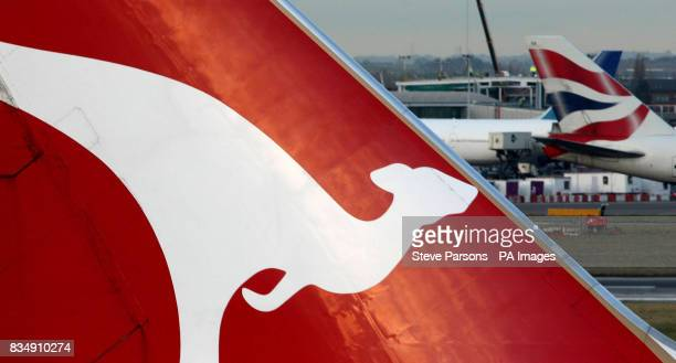 Qantas and BA planes sit at Terminal 4 of Heathrow Airport as a giant new airline could be formed following news that British Airways is in talks...