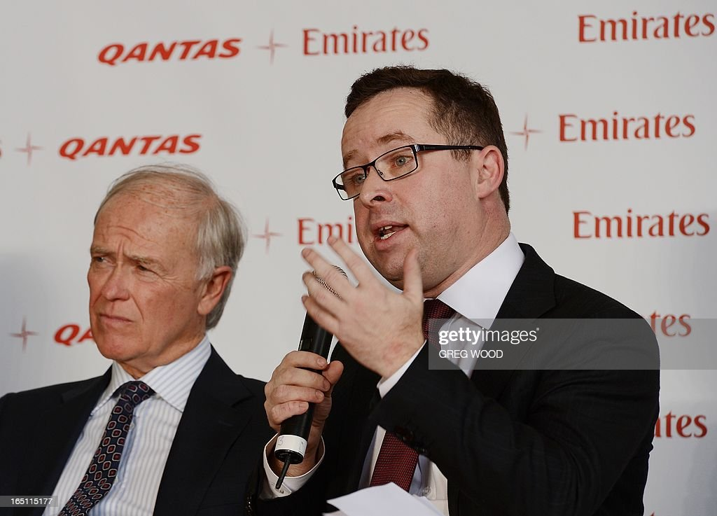 Qantas chief executive officer Alan Joyce (R) and Emirates president Tim Clark (L) attend a press conference at Sydney Airport on March 31, 2013 to mark the official launch of the partnership between the two airlines. The arrangement, approved by Australia's competition watchdog on March 27, allows the carriers to combine operations for an initial period of five years, including co-ordinating ticket prices and schedules. AFP PHOTO / Greg WOOD