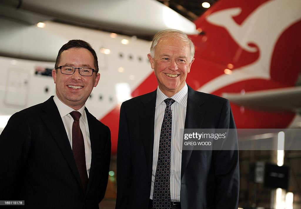 Qantas chief executive officer Alan Joyce (L) and Emirates president Tim Clark (R) attend a press conference at Sydney Airport on March 31, 2013 to mark the official launch of the partnership between the two airlines. The arrangement, approved by Australia's competition watchdog on March 27, allows the carriers to combine operations for an initial period of five years, including co-ordinating ticket prices and schedules. AFP PHOTO / Greg WOOD