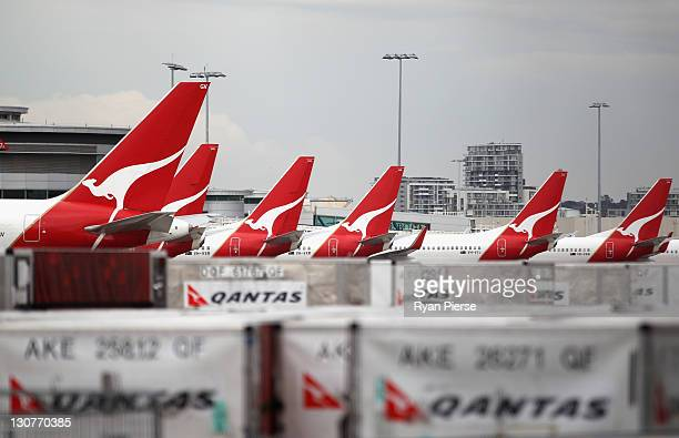Qantas jets are seen grounded at the Qantas Domestic Terminal on October 30 2011 in Sydney Australia Qantas CEO Alan Joyce announced at a press...