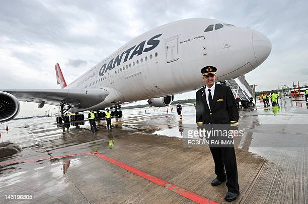 Qantas pilot captain Richard de Crespigny poses infront of the Qantas Airbus A380 jet dubbed 'Nancy Bird Walton' in honour of Australia's first...