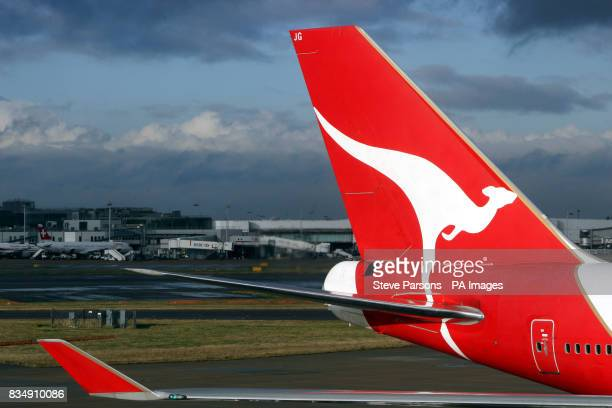 A Qantas plane sits at Terminal 4 of Heathrow Airport as a giant new airline could be formed following news that British Airways is in talks about a...