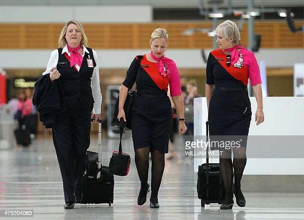 Qantas staff walk through the terminal of Sydney domestic airport on 27 February 2014 Struggling Australian carrier Qantas February 27 said it will...
