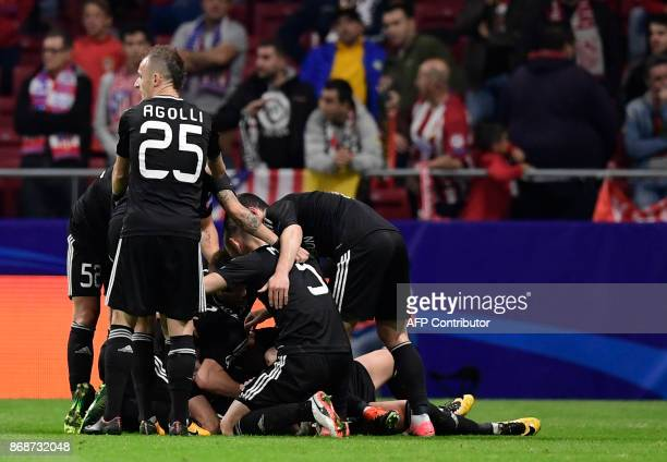 Qarabag players celebrate the opening goal during the UEFA Champions League football match Club Atletico de Madrid vs Qarabag FK at the Wanda...