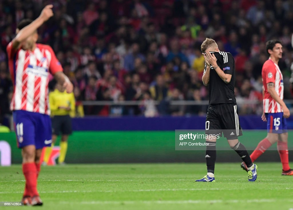 Qarabag's Brazilian midfielder Pedro Henrique covers his face after receiving a red card during the UEFA Champions League football match Club Atletico de Madrid vs Qarabag FK at the Wanda Metropolitano stadium in Madrid on October 31, 2017. /