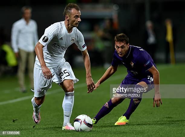 Qarabag's defender from Albania Ansi Agolli vies with Fiorentina's midfielder from Uruguay Sebastian Cristoforo during the Europa League football...