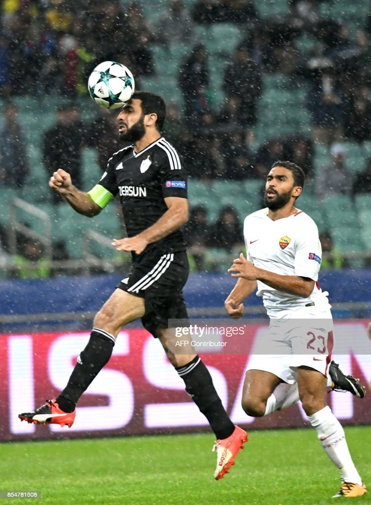Qarabag's defender from Azerbaijan Rashad Sadygov (L) and Roma's forward from France Gregoire Defrel vie for the ball during the UEFA Champions League Group C football match between Qarabag FK and AS Roma in Baku on September 27, 2017. / AFP PHOTO / Vano Shlamov