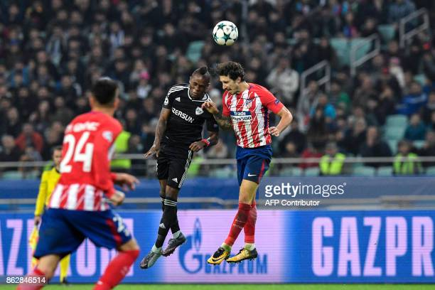 Qarabag's defender from Haiti Donald Guerrier and Atletico Madrid's defender from Croatia Sime Vrsaljko vie for the ball during the UEFA Champions...