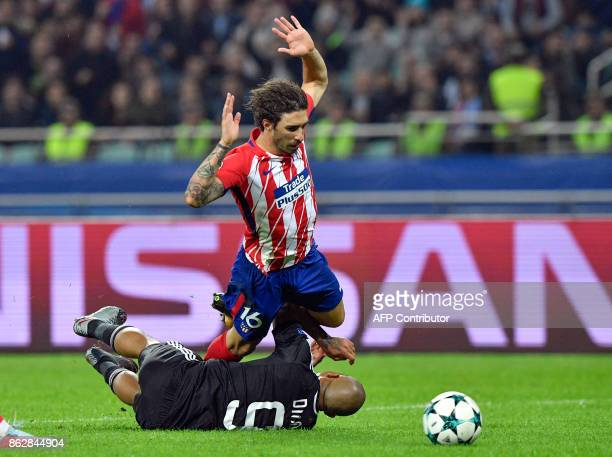 Qarabag's forward from South Africa Dino Ndlovu and Atletico Madrid's defender from Croatia Sime Vrsaljko vie for the ball during the UEFA Champions...