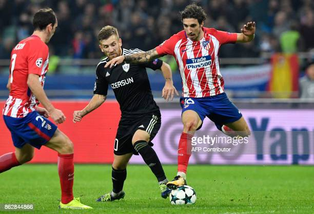 Qarabag's midfielder from Brazil Pedro Henrique and Atletico Madrid's defender from Croatia Sime Vrsaljko vie for the ball during the UEFA Champions...