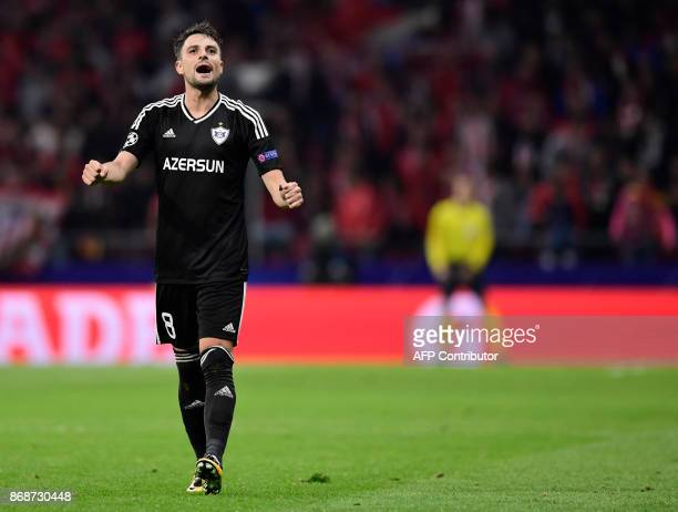 Qarabag's Spanish midfielder Michel celebrates a goal during the UEFA Champions League football match Club Atletico de Madrid vs Qarabag FK at the...