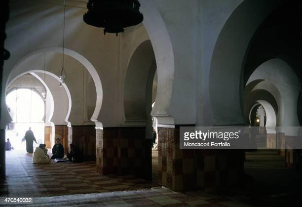 'Qarawiyyn Mosque 1th Century AD brickwork Morocco Fes Whole artwork view Interior of the Qarawiyyn Mosque characterized by horseshoe arches...